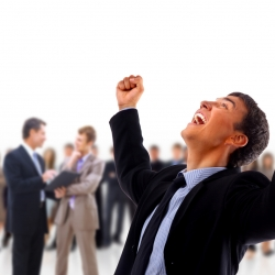 very happy energetic businessman with his arms raised